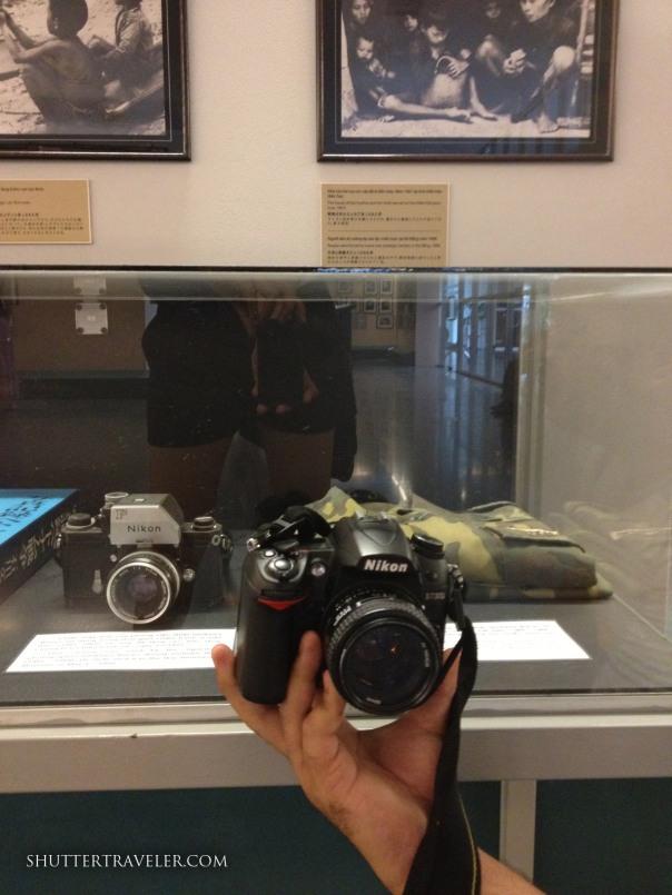 Comparing my DSLR Nikon with a war era viewfinder Nikon donated at the Museum